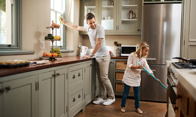 Father and Daughter Cleaning Cheerfully